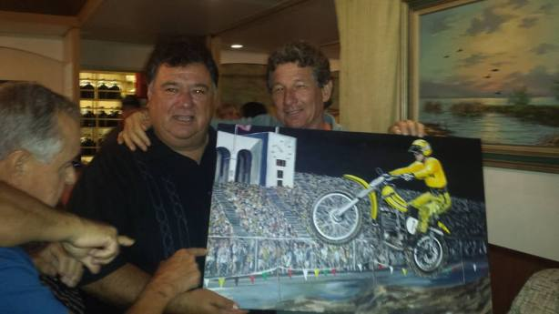 Marty receives the painting from Jim Beauchamp.